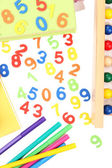 Colorful numbers, abacus, books and markers, isolated on white — Stock Photo
