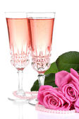 Composition with pink sparkle wine in glasses and pink roses isolated on white — Stockfoto