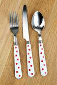 Kitchen cutlery on wooden table — Stock Photo