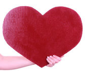 Hand holding big red heart isolated on white — ストック写真
