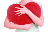 Female holding big red heart isolated on white — Photo
