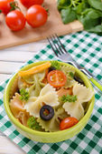 Delicious pasta with tomatoes on plate on table close-up — Stock Photo