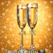 Two glasses of champagne on bright background with lights — Stock Photo #39804147