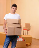 Young man moves into new home — Stock Photo