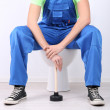 Plumber with toilet plunger on light background — Stock Photo #39904737