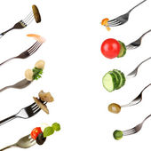 Collage of food on forks isolated on white — Stock Photo