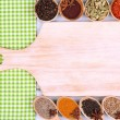 Various spices and herbs with empty wooden board — Stock Photo #39935779