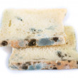 Stock Photo: Mouldy bread, isolated on white