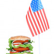 Composition with huge burger and flag, isolated on white — Stock Photo #39936235