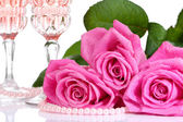Composition with pink sparkle wine in glasses and pink roses isolated on white — Stock Photo