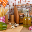 Stock Photo: Cooking food in kitchen on table on mosaic tiles background