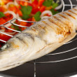 Delicious grilled fish on wok close-up — Stock Photo