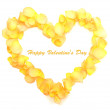 Beautiful heart of yellow rose petals isolated on white — Stock Photo