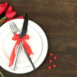 Romantic holiday table setting, on wooden background — Stock Photo #39956961