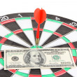 Dart on dartboard and money close up. Concept of success. — Stock Photo #39956993