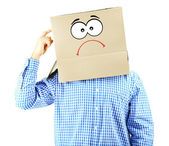 Man with cardboard box on his head isolated on white — Stock Photo