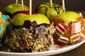Candied apples on sticks close up — Stock Photo