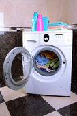 Washing machine loaded with clothes in bathroom — Stock Photo