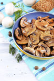 Delicious fried mushrooms in pan on table close-up — Stock Photo