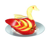 Carving fruit pattern of swan isolated on white — Stock Photo