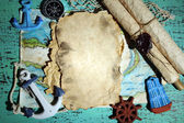 Old paper with sea accessories, isolated on wooden background — Stock Photo