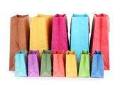 Beyaz izole renkli alışveriş torbaları — Stok fotoğraf