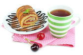 Cup of tea and sweets isolated on white — Stock Photo