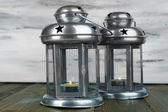 Decorative metallic lantern on wooden table on wooden background — Stock Photo