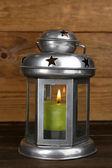 Decorative metallic lantern on wooden background — Stock Photo