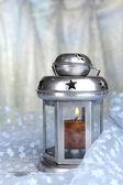 Decorative metallic lantern on fabric background — Stock Photo