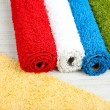 Many carpets of different colors close-up — Stock Photo #40031559