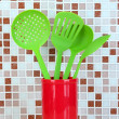 Stock Photo: Cooking utensils in kitchen on table on mosaic tiles background