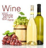 Barrel and bottles of wine and ripe grapes isolated on white — Stock Photo
