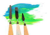 Painting palette knifes with paint isolated on white — Stock Photo