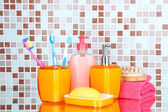 Cosmetics and bath accessories on mosaic tiles background — Stock Photo