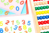 Colorful numbers, abacus, books and markers, isolated on white — Foto Stock