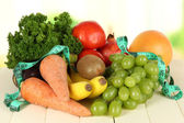 Fresh vegetables on table on light background — Stock Photo