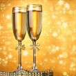 Two glasses of champagne on bright background with lights — Stock Photo #40203813
