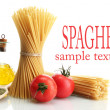 Pasta spaghetti, tomatoes and oil, isolated on white — Stock Photo