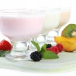 Delicious yogurt with fruit and berries isolated on white — Stock Photo #40205307