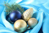 Beautiful Christmas decor on blue satin cloth — Stock Photo