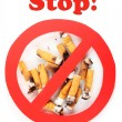 Cigarette butts with prohibition sign isolateed on white — Stock Photo #40277499