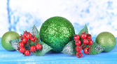 Composition of Christmas decorations on table on light background — Stock Photo