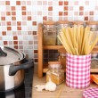 Stock Photo: Pot on stove in kitchen on table on mosaic tiles background