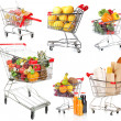 Trolleys with different products isolated on white — Stock Photo #40287683