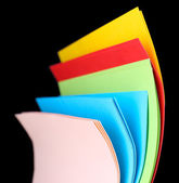 Colorful art paper on black background — Stock Photo