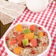 Stock Photo: Delicious oatmeal with fruit in bowl on table close-up