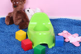 Green potty on home interior background — Stock Photo