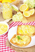 Delicious toasts with lemon jam on plate on table close-up — Stockfoto