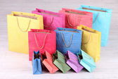 Colorful shopping bags, on light background — Stock Photo
